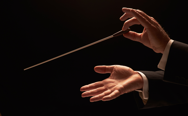 hands conducting music