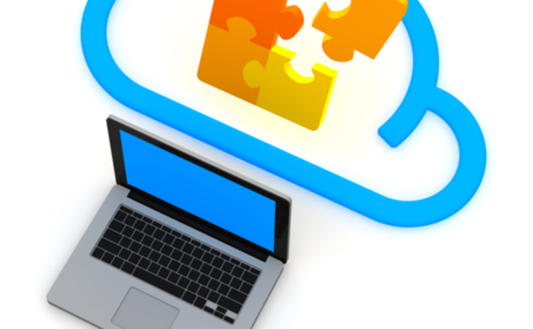 A graphic of a jigsaw in the cloud emerging from a laptop