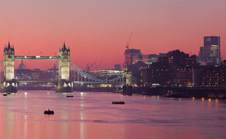 A view of the River Thames and Tower Bridge in London at sunset