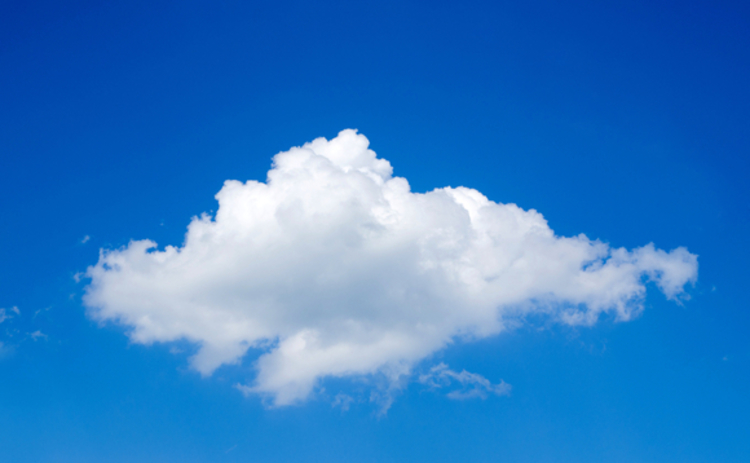 A single cloud floating in a clear blue sky